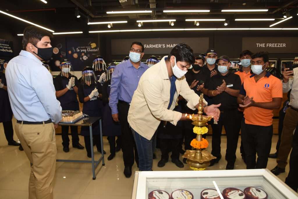 Pic-2-Mr-Harshavardhan-Chauhaan-Vice-President-Marketing-Natures-Basketlighting-candle-at-the-inauguration-of-the-launch-of-Natures-Basket-at-Forum-Courtyard-Mall-Kolkata-scaled.jpg