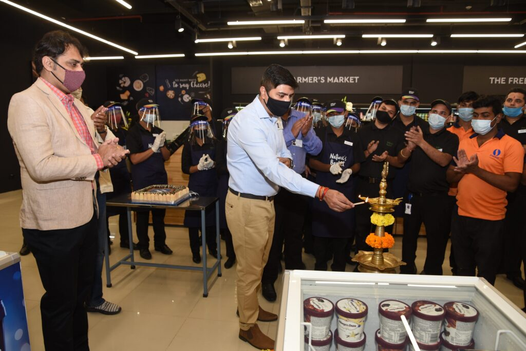 Pic-3-Mr.-Vijeet-ShekhawatVice-President-Business-Head-Natures-Basket-lighting-candle-at-the-inauguration-of-the-launch-of-Natures-Basket-at-Forum-Courtyard-Mall-Kolkata-scaled.jpg